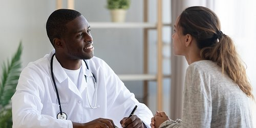 Alcohol Rehab Professional Talking To A Patient